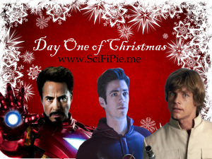 "Iron Man, the Flash and Luke Skywalker standing in front of a Christmas backdrop with ""Day One Of Christmas"" written above them"